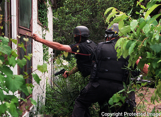 Members of the South Daytona Police Department tactical response team perform a dynamic entry upon a house in South Daytona, Florida.(Brian Myrick)