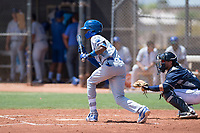 AZL Royals shortstop Maikel Garcia (4) shows bunt in front of catcher Rainier Aguilar (8) during an Arizona League game against the AZL Padres 1 at Peoria Sports Complex on July 4, 2018 in Peoria, Arizona. The AZL Royals defeated the AZL Padres 1 5-4. (Zachary Lucy/Four Seam Images)