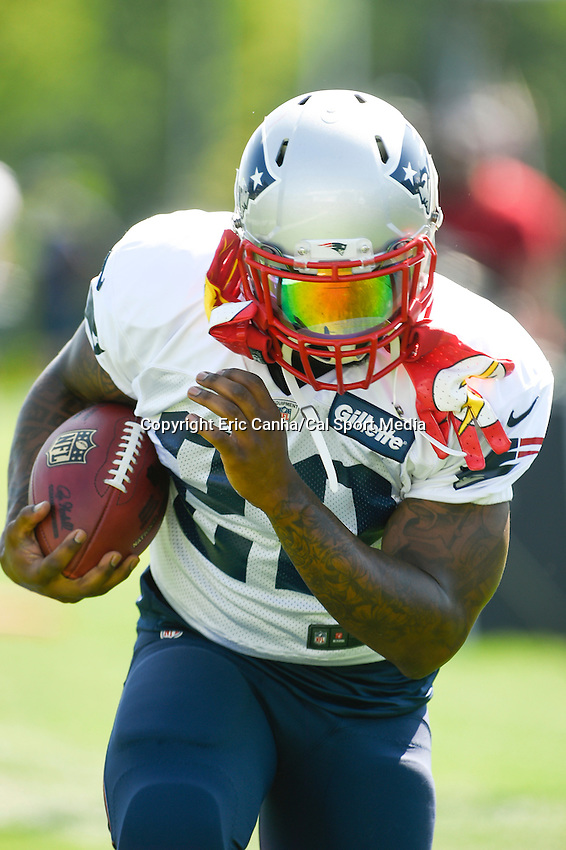 July 29, 2014 - Foxborough, Massachusetts, U.S.- New England Patriots running back Stevan Ridley (22) carries the ball during the New England Patriots training camp held at Gillette Stadium in Foxborough Massachusetts.  Eric Canha/CSM