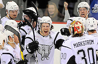San Antonio Rampage's Bracken Kearns, center, celebrates the win with teammates after an AHL playoff hockey game against the Chicago Wolves, Thursday, April 19, 2012, in San Antonio. San Antonio won 5-4 in overtime. (Darren Abate/pressphotointl.com)