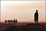 A family pass by the village of Dasht-e-Qala, Takhar Province.<br /> <br /> Afghanistan 9 October 2001
