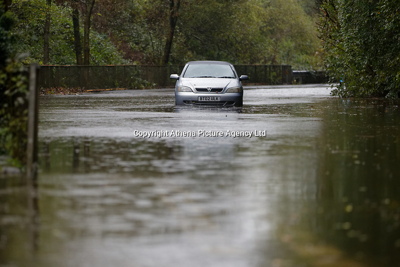 Pictured: A Vauxhall Astra convertible is stranded on the B4242 road between Resolven and Glyn Neath in south Wales, UK. Saturday 13 October 2018<br /> Re: Flooding caused by Storm Callum in the Neath area, south Wales, UK.