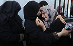 Relatives of Palestinian Osama Abu Khater, who died of wounds he sustained during clashes with Israeli troops, mourn during his funeral in Khan Younis in the southern Gaza Strip on June 24, 2018. Photo by Ashraf Amra