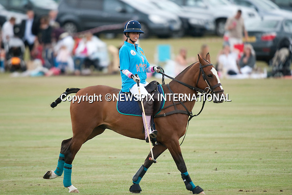"Katie Price .Plays in 2010 Asprey World Class Cup Polo, played at Kenny Jones'Hurtwood Park, Surrey_England_17/07/2010..Mandatory Photo Credit: ©Dias/Newspix International..**ALL FEES PAYABLE TO: ""NEWSPIX INTERNATIONAL""**..PHOTO CREDIT MANDATORY!!: NEWSPIX INTERNATIONAL(Failure to credit will incur a surcharge of 100% of reproduction fees)..IMMEDIATE CONFIRMATION OF USAGE REQUIRED:.Newspix International, 31 Chinnery Hill, Bishop's Stortford, ENGLAND CM23 3PS.Tel:+441279 324672  ; Fax: +441279656877.Mobile:  0777568 1153.e-mail: info@newspixinternational.co.uk"