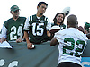 Matt Forté #22, New York Jets running back, signs autographs for fans after a day of team training camp at Atlantic Health Jets Training Center in Florham Park, NJ on Saturday, Aug. 6, 2016