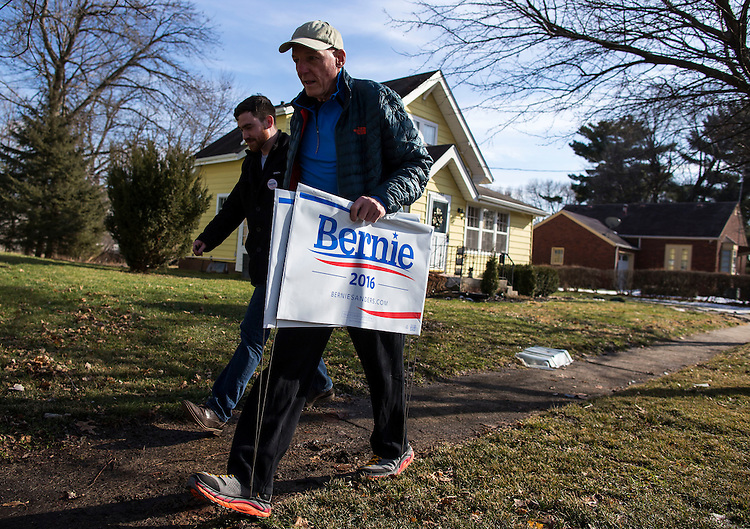 UNITED STATES - FEB 2. - Roger Zagar, of Des Moines, and Ryan Hurley, from Regina, Saskatchewan, Canada, who works with Member of Parliament Erin Weir, walk as they knock on doors while canvassing the Union Park neighborhood,  Monday, Feb. 1, 2016 in Des Moines, Iowa. (Photo By Al Drago/CQ Roll Call)