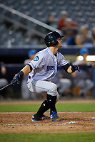 Hudson Valley Renegades catcher Erik Ostberg (21) follows through on a swing during a game against the Connecticut Tigers on August 20, 2018 at Dodd Stadium in Norwich, Connecticut.  Hudson Valley defeated Connecticut 3-1.  (Mike Janes/Four Seam Images)