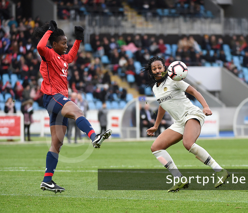 20190113 - LILLE , FRANCE : LOSC's Laetitia Chapeh (L) and PSG's Marie Antoinette Katoto (R) pictured during women soccer game between the women teams of Lille OSC and Paris Saint Germain  during the 16 th matchday for the Championship D1 Feminines at stade Lille Metropole , Sunday 13th of January 2019,  PHOTO Dirk Vuylsteke | Sportpix.Be