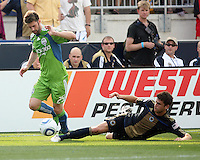 Stefani Miglioranzi #6 of the Philadelphia Union slides into Pat Noonan #25 of the Seattle Sounders FC during the first MLS match at PPL stadium in Chester, Pa. on June 27 2010. Union won 3-2.