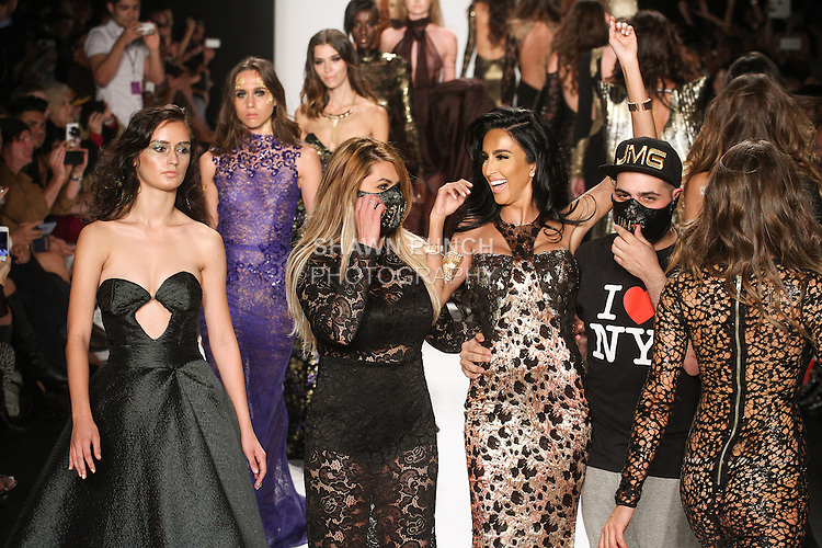 """Fashion designers and siblings Stepanie and Michael Costello walk runway with models for the close of the MTCostello Spring Summer 2015 """"Illuminati Collection"""" runway show, for the Art Hearts Fashion Spring 2015 fashion show, during Mercedes-Benz Fashion Week Spring 2015 in New York City."""