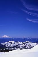 Mt Adams and Mt Hood emerge dramatically from the Cascade Range, south of Mt Rainier, Washington, USA