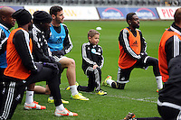 Wednesday, 23 April 2014<br /> Pictured: 10 year old William Humphreys (C) who trained with the men's team as a birthday present.<br /> Re: Swansea City FC are holding an open training session for their supporters at the Liberty Stadium, south Wales,