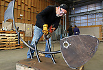 WATERBURY CT. 12 October 2017-101217SV05-Eduardo Giannattasio works on his fish sculpture in Waterbury Thursday. Five internationally-known Italian artists who wanted to pay homage to sculptor Alexander Calder had the singular idea to create their work in the same place where Calder created his. <br /> Steven Valenti Republican-American