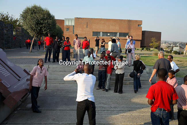 A school class take pictures at the Hector Pietersen memorial and museum. The location of the student upprisings in 1976.