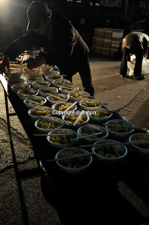 Over 700 meals are prepared for the homeless in Shinjuku Park, central Tokyo  15 February 2009.   The numbers of homeless has sky-rocketed in recent months.  According charity groups who distribute food and blankets, numbers have increased by 80% in many central Tokyo parks as people have lost hundreds of thousands of jobs since the financial crisis that started in earnest year in November 2008.