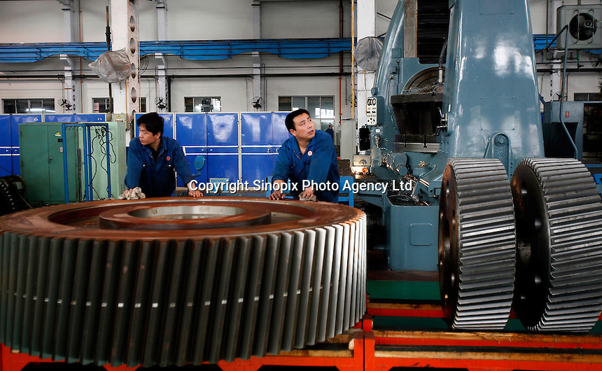 Employees at work seen here at the CITIC Heavy Industries LTD. in Luoyang, Henan Province, China. Formerly known as the Luoyang Mining Machinery Factory, the plant makes heavy equipment used in various fields such as mining, hydro electric, etc..