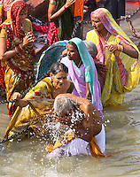Kumbh Mela is the largest pilgrimage festival known to man, it occurs after every 12 years in Haridwar, India. This year Haridwar Maha Kumbh bathing dates fall when Venus & Jupiter coincides with Aquarius Sun & Moon is on the Aries and Sagittarius, respectively. It's widely believed that taking a dip at any of the Holy Rivers like Ganges, Yamuna & celestial Sarawati at Parayag (Sangam at Allahbad) offers purity, wealth, and fertility and wash away the sins of those who bath in it. The main & common reason for one to attend the holy festival of Kumbh Mela is to take dip in Holy Ganges. It is said that a holy dip in sacred rivers during such Kumbh festival takes human out of the circle of life & death (Moksha).<br /> The origin of the Kumbh is very old and dates back to the mystical time when the demigods and demons assembled together on the shore of a mythological ocean of milk and churned the sea to produce the nector of immortality (the Amrit). It was agreed to be shared equally between them afterwards. The mystical Mandara Mountain was used as churning rod and Vasuki, the mythological king of all serpents, became the rope for churning. With the demigods at Vasuki's tail and the demons at his head, they churned the ocean for 10, 000 years and produced one pot of nectar. The demigods were fearful of what would happen if and demons drank their share. So they stole away the pot and tried to hide it. This resulted into a great and prolonged chase which lasted 12 symbolic days and nights during which the demigods and demons went round the earth. The demigods put nectar pot (Amrita Kalasha) at Haridwar, Prayag, Ujjain and Nasik, where such Kumbh Melas are organized periodically to commemorate this holy event every 12 years.