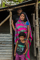 Bangladesh, Jhenaidah. Neema and her husband are caretakers for the public toilets in the local market. She collects the money and he cleans them. They collect 2 TK each for about 100 customers a day so they make about 200 TKs or $2 a day. they live in a local slum and have one daughter. He tends to take the money and drink.  Most of these people living in this slum are Dalit Hindu, or the untouchable caste working as sweepers and toilet cleaners. There are about 5.5 million Dalit across the country, they are most neglected caste in their society. The SNV Development Organization is providing fecal sludge management and occupational safety training for toilet and septic tank cleaners. Cleaning the toilets. Model released.