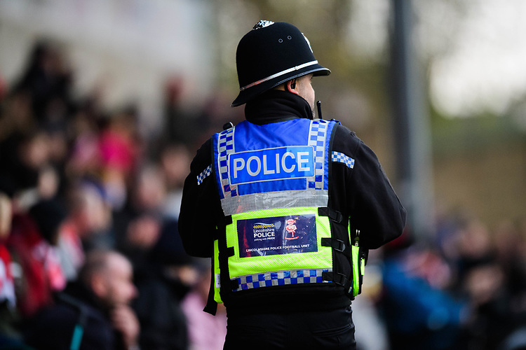 A police officer from Lincolnshire Police's football unit<br /> <br /> Photographer Chris Vaughan/CameraSport<br /> <br /> The EFL Sky Bet League Two - Lincoln City v Mansfield Town - Saturday 24th November 2018 - Sincil Bank - Lincoln<br /> <br /> World Copyright © 2018 CameraSport. All rights reserved. 43 Linden Ave. Countesthorpe. Leicester. England. LE8 5PG - Tel: +44 (0) 116 277 4147 - admin@camerasport.com - www.camerasport.com