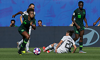 GRENOBLE, FRANCE - JUNE 22: Francisca Ordega #17 of the Nigerian National Team works to clear ball during a game between Nigeria and Germany at Stade des Alpes on June 22, 2019 in Grenoble, France.