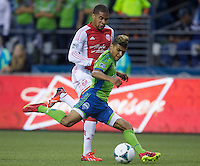 DeAndre Yedlin, right, of the Seattle Sounders FC passes the ball in front of Ryan Johnson of the Portland Timbers during play at CenturyLink Field in Seattle Saturday August, 3, 2013. The Sounder won the match 1-0.