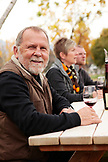 USA, Oregon, Medford, Cal Schmidt enjoys a glass of wine on his farm with friends, Schmidt Family Vineyards is located in the beautiful Applegate Valley and is owned by Judy and Cal Schmidt, the winery consists of country charm, beautiful gardens and fine wines
