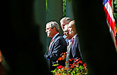 Washington, D.C. - September 3, 2005 -- United States President George W. Bush delivers his weekly radio address live from the Rose Garden on September 3,2005. Left to right: The President, Chairman of the Joint Chiefs of Staff Richard Myers, United States Air Force, United States Secretary of Defense Donald Rumsfeld, and Secretary of the United States Department of Homeland Security Michael Chertoff. <br /> Credit: Dennis Brack - Pool via CNP