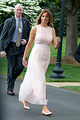 "First lady Melania Trump walks back to the West Wing after reading ""Party Animals"" by Kathie Lee Gifford to a group of children as she and United States President Donald J. Trump host the annual Easter Egg Roll on the South Lawn of the White House in Washington, DC on Monday, April 17, 2017.<br /> Credit: Ron Sachs / CNP"