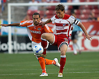FC Dallas' Simo Valakari (17) plays the ball  infront of Houston Dynamo's Dwayne De Rosario (14) at Robertson Stadium in Houston, TX on Saturday May 6, 2006. The Houston Dynamo defeated FC Dallas 4-3.