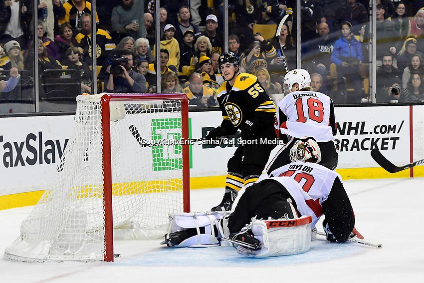 April 7, 2018: Boston Bruins center Noel Acciari (55) scores a goal against Ottawa Senators goaltender Daniel Taylor (70) during the NHL game between the Ottawa Senators  and the Boston Bruins held at TD Garden, in Boston, Mass. Boston defeats Ottawa 5-2 Eric Canha/CSM