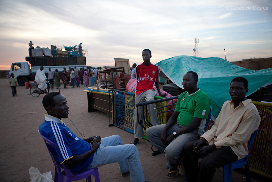 5 january 2011 - Khartoum, Sudan - Southern Sudanese in the north sit near their belongings while waiting to load them on a truck as they prepare to leave for the south before the secession referendum, in an area called Soba in Khartoum. The referendum, guaranteed by a 2005 peace deal between north and south which ended Africa's longest civil war, is forecast to result in secession, but exactly how the two countries will begin to disentangle their economies, resources and people is far from clear. Photo credit: Benedicte Desrus