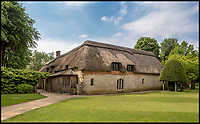 BNPS.co.uk (01202 558833)<br /> Pic: Savills/BNPS.<br /> <br /> Thatched cottages and outbuildings are included in the sale.<br /> <br /> One of Dorset's finest country Manor's is up for sale - but you'll need a cool £7.5 million to buy it.<br /> <br /> A stunning Tudor manor house that has been visited by writer Thomas Hardy and actors Michael Caine and Laurence Olivier is on the market for £7.5m.<br /> <br /> Athelhampton House dates back to the 15th century and was used as a film location for the 1972 film Sleuth, starring Michael Caine and Laurence Olivier.<br /> <br /> The Grade I listed property is in the heart of Hardy Country in Puddletown, near Dorchester, Dorset, and Hardy was a regular visitor to the house, which his stonemason father worked on.<br /> <br /> For the last 60 years, it has been owned by the Cooke family with three generations of the family building on and enhancing the legacy of the historic home.<br /> <br /> But the house is now on the market with estate agents Savills and Knight Frank.