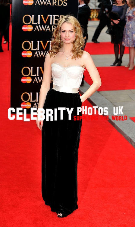 Lily James  at The Laurence Olivier Awards at the Royal Opera House on April 28, 2013 in London Picture By: Brian Jordan / Retna Pictures.. ..-..