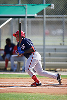 GCL Nationals catcher Onix Vega (8) follows through on a swing during a game against the GCL Cardinals on August 5, 2018 at Roger Dean Chevrolet Stadium in Jupiter, Florida.  GCL Cardinals defeated GCL Nationals 17-7.  (Mike Janes/Four Seam Images)