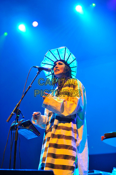 Bianca Casady of 'Cocorosie' .performing live in concert as part of the Meltdown Festival, Royal Festival Hall, Waterloo, London, England, UK, .4th August 2012..half length music gig yellow striped dress hat costume microphone singing on stage .CAP/MAR.© Martin Harris/Capital Pictures.