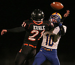 HOWARD, SD - NOVEMBER 8:  Jordan Kuhle #21 from Howard breaks up a pass intended for Zachary Ronning #10 from Alcester Hudson in the first half of their Class 9A Semifinal game Saturday night in Howard. (Photo by Dave Eggen/Inertia)