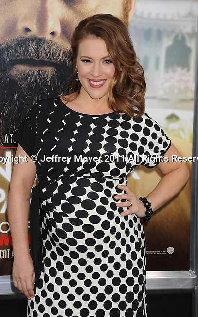 "HOLLYWOOD, CA - MAY 19: Alyssa Milano arrives at the Los Angeles premiere of ""The Hangover Part II"" at Grauman's Chinese Theatre on May 19, 2011 in Hollywood, California."