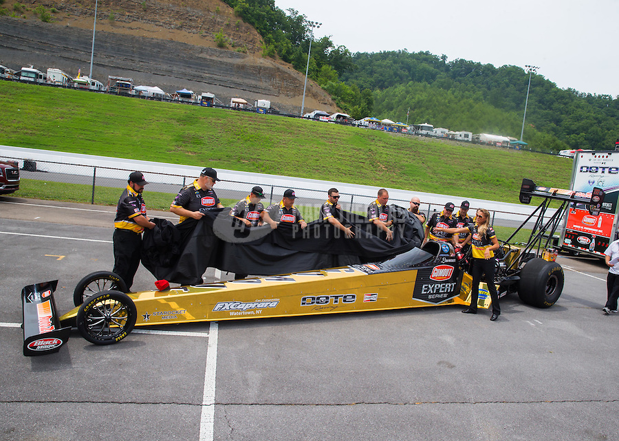 Jun 19, 2015; Bristol, TN, USA; Crew members unveiling the new paint scheme for NHRA top fuel driver Leah Pritchett during qualifying for the Thunder Valley Nationals at Bristol Dragway. Mandatory Credit: Mark J. Rebilas-