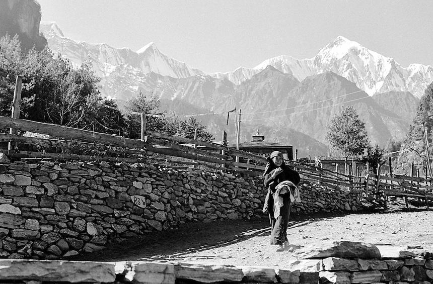 A woman walks through a small town in the Annapurna Himal, Nepal, 2008. Photo: Ed Giles.