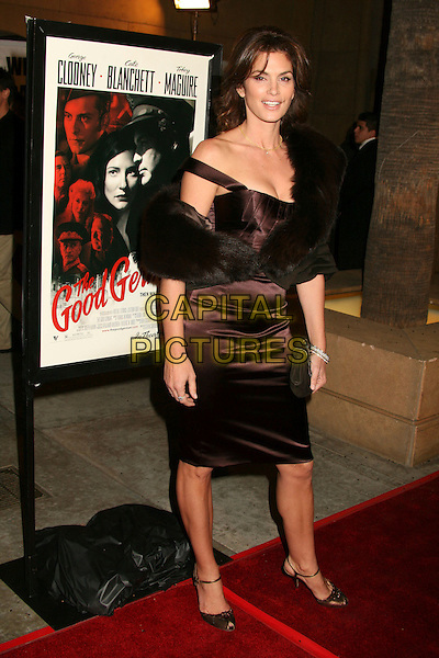 "CINDY CRAWFORD.Hollywood, California. Atmosphere. Los Angeles Premiere of ""The Good German"" at the Egyptian Theatre, Hollywood, California, USA..December 4th, 2006.full length black purple brown dress fur wrap .CAP/ADM/BP.©Byron Purvis/AdMedia/Capital Pictures"
