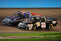 Nov. 13, 2009; Avondale, AZ, USA; NASCAR Camping World Truck Series driver Tim George Jr. (22) races alongside James Buescher during the Lucas Oil 150 at Phoenix International Raceway. Mandatory Credit: Mark J. Rebilas-