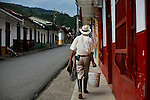 A local resident walks in the town of Jardin in Antioquia August 1, 2012. Photo by Eduardo Munoz Alvarez / VIEW.