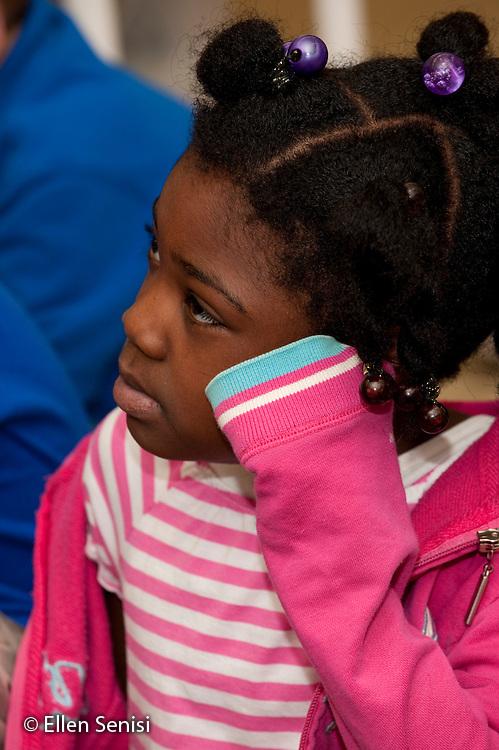MR / Schenectady, New York. Zoller Elementary School (urban public school). First Grade Inclusion class. Portrait of student (girl, 6, African-American, Autistic) listening in class. ID: AJ-g1b. MR: Bai5 ©Ellen B. Senisi