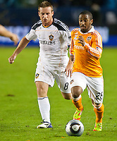 CARSON, CA - November 20, 2011: LA Galaxy midfielder Chris Birchall and Houston Dynamo midfielder Corey Ashe (26) during the MLS Cup match between LA Galaxy and Houston Dynamo at the Home Depot Center in Carson, California. Final score LA Galaxy 1, Houston Dynamo 0.