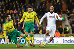 David McGoldrick (r) of Sheffield United is challenged by Mario Vrancic (L) of Norwich City during the Premier League match at Carrow Road, Norwich. Picture date: 8th December 2019. Picture credit should read: James Wilson/Sportimage