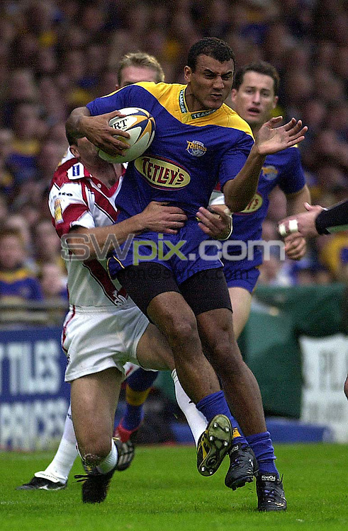 Pix: Ben Duffy/SWpix.com.  Rugby Super League....Leeds v St Helens...07/06/2002..COPYWRIGHT PICTURE>>SIMON WILKINSON>>01943 436649>>..Leeds Mark Calderwood is pulled down bySt Helens Peter Shiels