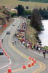 Runners competing in the 10K and half-marathon during the annual Chelanman Multisport weekend head out along Hwy. 97A which has paid for traffic control measures in place to insure safety of the competitiors