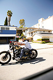 USA, Los Angeles, a motorcyclist riding his motorcycle down the road near Mulholland Dr.