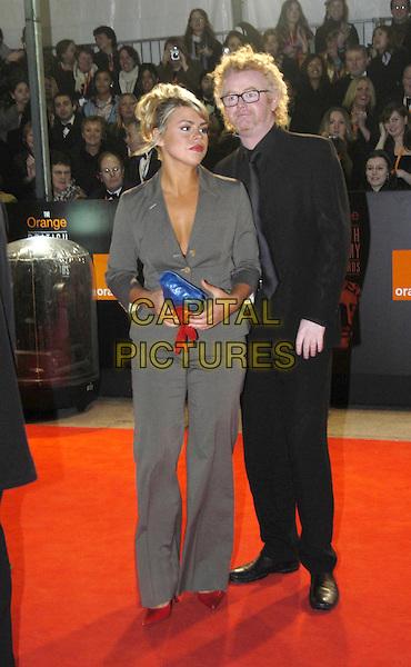 BILLIE PIPER & CHRIS EVANS.Bafta Awards - British Academy Awards at Odeon Leicester Square.15 February 2004.full length, full-length, celebrity couple, grey, gray suit, black suit, blue handbag.www.capitalpictures.com.sales@capitalpictures.com.©Capital Pictures
