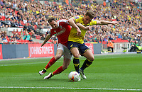 Alex MacDonald of Oxford United and Aidan White of Barnsley tussle for the ball during the Johnstone's Paint Trophy Final match between Oxford United and Barnsley at Wembley Stadium, London, England on 3 April 2016. Photo by Alan  Stanford / PRiME Media Images.